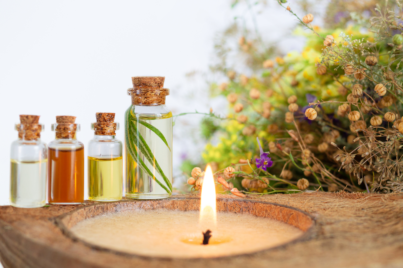 About us - Essential oils spa set with burning candle, healthy herbs and flower